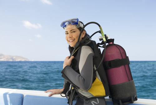 A woman about to go scuba diving